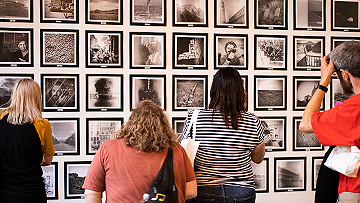 People viewing images at a gallery